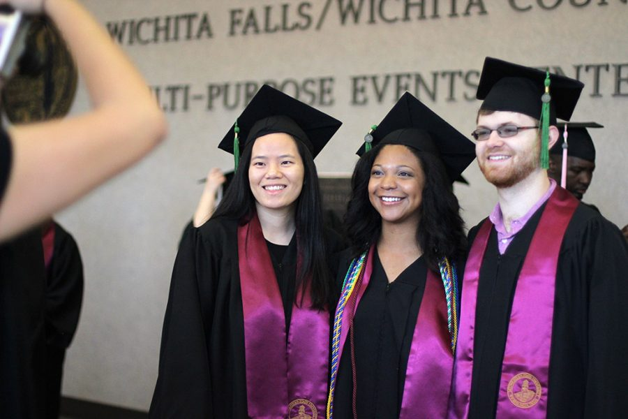 Alden Thompson, radiology, Teresa Perez, radiology, and Devin Helsel, radiology, take a picture together upon arriving early to Commencement, waiting for the check in line to begin, Satruday May, 12, 2018. Photo by Rachel Johnson