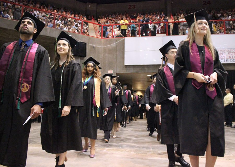 Graduates file into Kay Yeager Coliseum for Commencement, May 12, 2018. Photo by Rachel Johnson