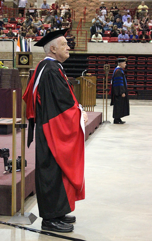 Both Everett Kindig, history professor, and Phillip Wilson, associate professor of marketing, walk with their MSU mace for the last year, as they both retired, at Commencement, May 12, 2018. Photo by Rachel Johnson