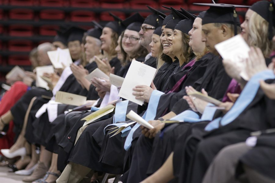 Ruby Arriaga, master's of education, and other graduates applaud during the Midwestern State University Commencement at Kay Yeager Coliseum on Saturday, May 12, 2018. Photo by Francisco  Martinez