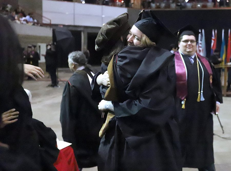 Erin Harman, art graduate, hugs Catherine Prose, art professor, at the spring 2018 graduation at Kay Yeager Coliseum on May 12, 2018. Photo by Justin Marquart