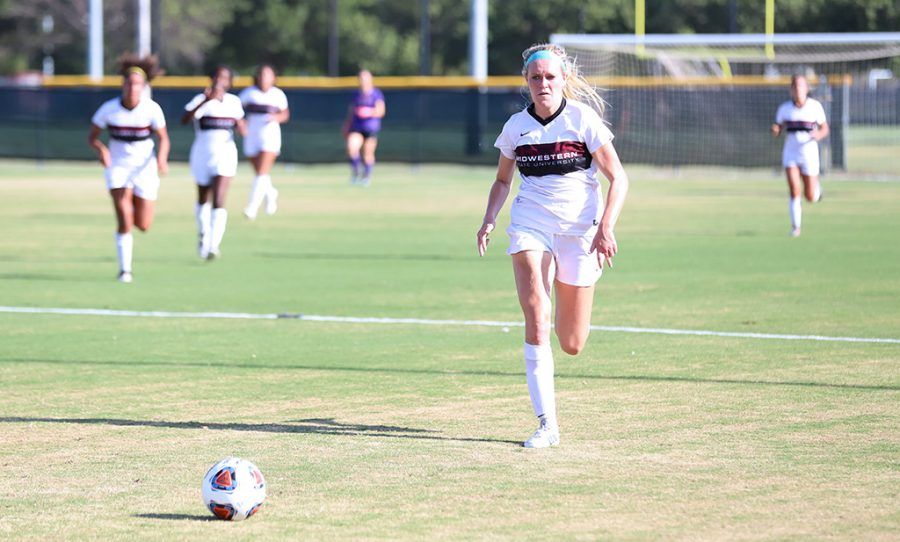 Early childhood education junior and forward Avery Lewis takes a run up the field against New Mexico Highlands University. August 30. Photo by Bridget Reilly