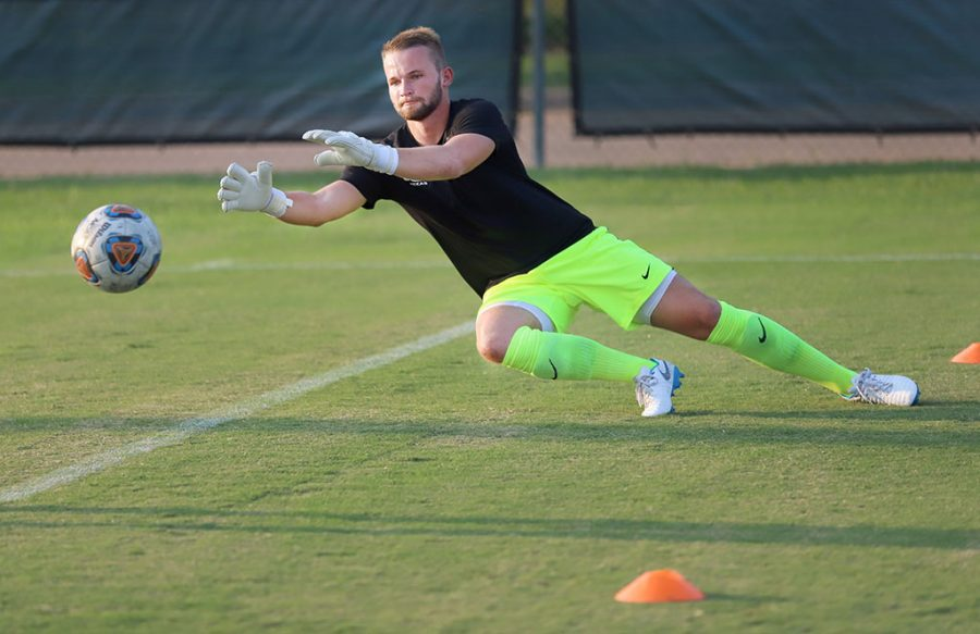 Mitchell Kurtz, deoscience redshirt sophomore and goal keeper, practices drills before the preseason game against Sountern Nazarene at Stang Park on Aug. 22. Photo by Justin Marquart