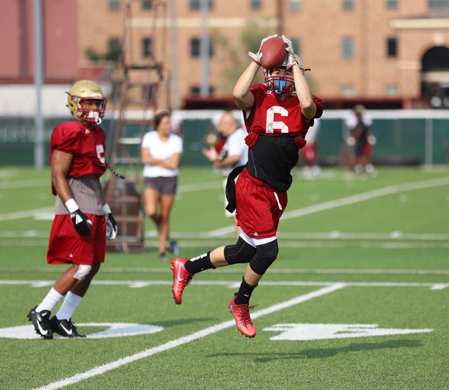 Bryce Martinez catches the ball during practice on the practice field on Aug. 22. Photo by Justin Marquart