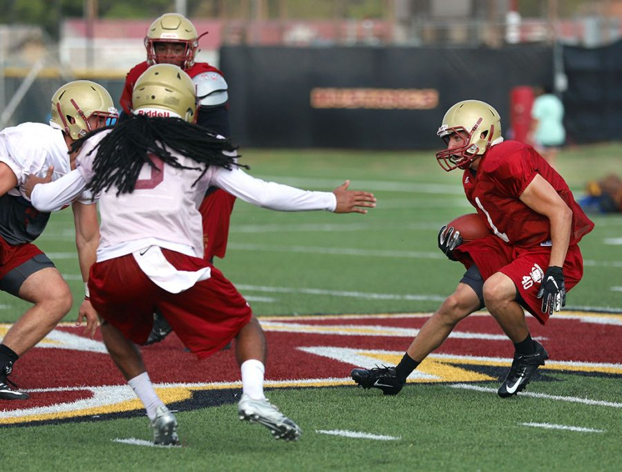 Justin Jones, running back, during practice on the practice field on Aug. 22. Photo by Justin Marquart
