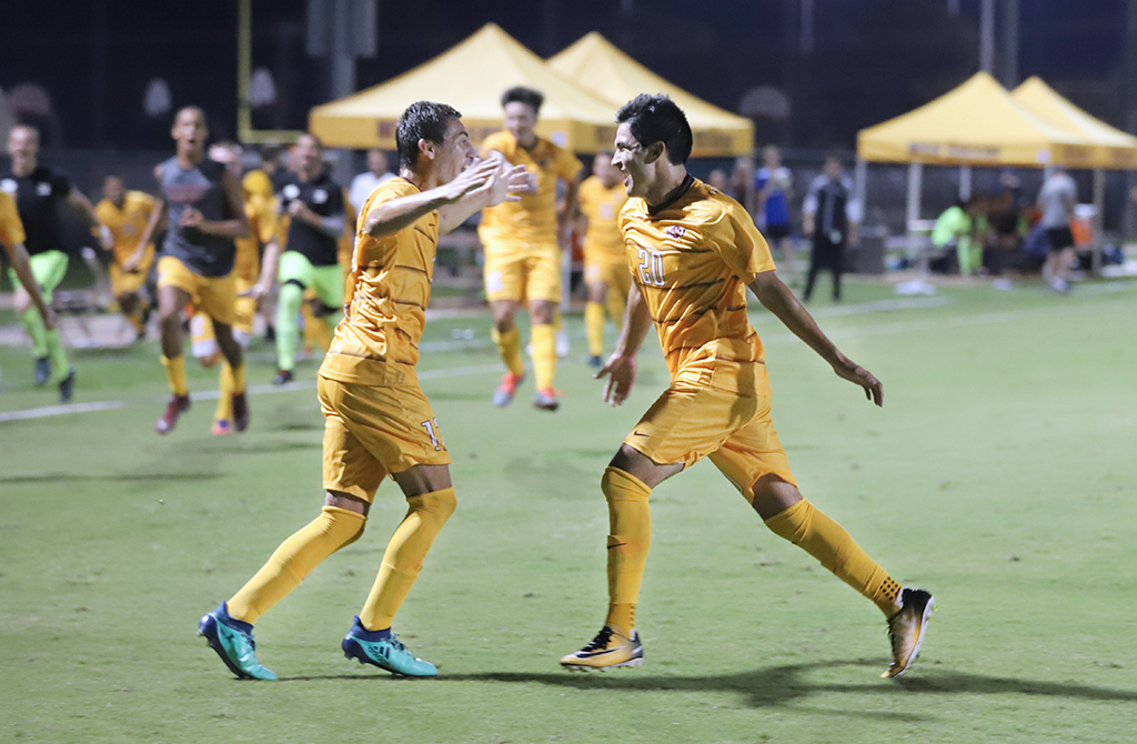 Kinesiology+sophomore+and+midfielder+Carlos+Flores+embraces+undecided+sophomore+and+midfielder+Julian+Barajas+for+scoring+a+goal+against+Rodgers+State.+Sept.+13.+Photo+by+Bridget+Reilly