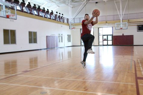 Between class and football, Austin Boyd, undecided freshman, finds time to play basketball to challenge and entertain himself at the Wellness Center on Tuesday, Sept. 4, 2018. Photo by Cortney Wood