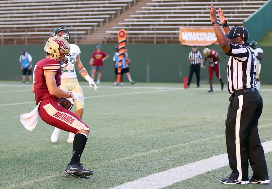 Bryce Martinez, criminal justice sophomore and wide receiver, scores a touchdown at the first football game against Humboldt at Memorial Stadium on Sept. 1. Martinez scored two touchdowns during the game. Mustangs win by 43 points, 55-12. Photo by Justin Marquart