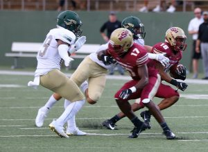 Kylan Harrison, redshirt freshman and wide receiver, blocks a tackle while Anthony Tennison, redshirt freshman kinesiology and wide receiver, runs the ball down the field at the first football game against Humboldt at Memorial Stadium on Sept. 1. Mustangs win by 43 points, 55-12. Photo by Justin Marquart