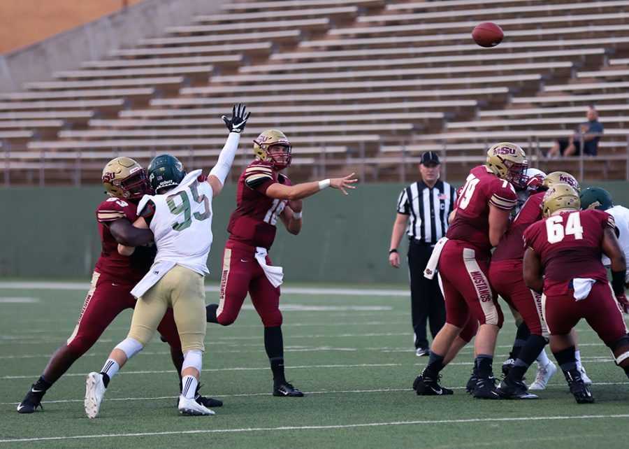 Layton Rabb, accounting senior and quarterback, throws the ball down the field at the first football game against Humboldt at Memorial Stadium on Sept. 1. Mustangs win by 43 points, 55-12. Photo by Justin Marquart