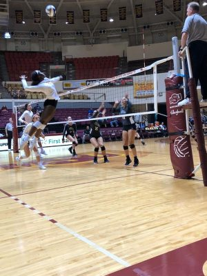 Sophomore Raven Presley gets ready to spike the ball against Eastern New Mexico University during the home game on Sept. 7.