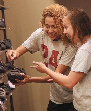 Cross Country and Track Team donates running shoes to children in need