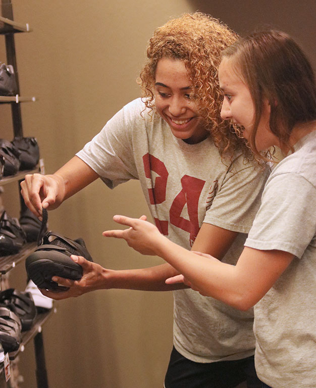 Finance junior and cross country athlete Jasmine Amo and exercise physiology junior and cross country athlete Sierra Stucky join the MSU cross country team donating their shoes to the Endurance House shoe drive to give to high school kids across Wichita Falls.