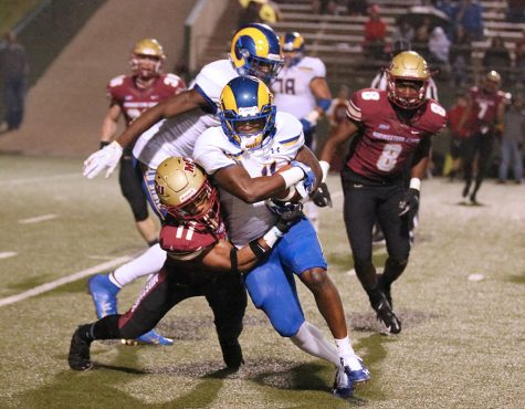 Computer science junior, Marcus Wilkerson takes down Angelo State University offensive player at game against Angelo State University. Sep 21. Photo by Brittni Vilandre