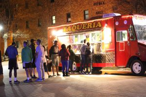 Students wait in line to grab food from the El Norteno food truck, they had a $1 taco sale during Club Piecre, held on Mustangs Walk, March 17, 2016. Photo by Makayla Burnham