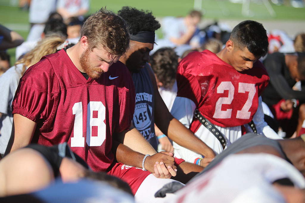 Layton+Rabb%2C+quarterback+and+a+senior+in+accounting%2C+prays+after+football+practice+Sept.+19%2C+2018.+The+team+had+24+seconds+of+silence+in+honor+of+Robert+Grays+who+died+in+a+football+accident+last+fall.+Photo+by+Bradley+Wilson