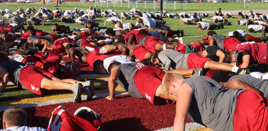 About 400 students and athletes came together to do 24 pushups in remembrance Robert Grays.