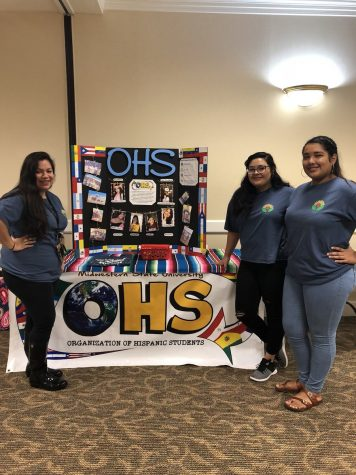 Luz Garcia, nursing sophomore and Daisy Reyes, mass communication sophomore and Samantha Mejia, accounting sophomore talk about OHS at the organization fair that took place before the Empower Me! Summit on Sept. 8.