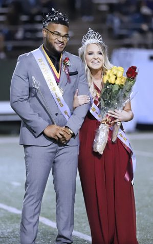 Mass communication seniors Treston Lacy and Morgan Haire pose as king and queen at the homecoming game against Tarleton at Memorial stadium Oct. 27.