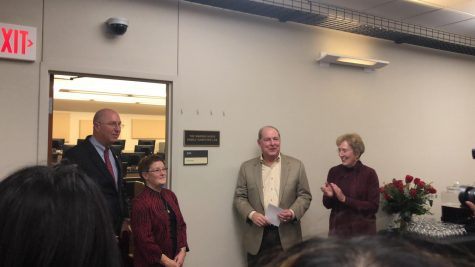 Warren and Pam Ayres, with the help of Jeff Stambaugh, unveiled the plaque at the Warren Ayres Family Computer Lab Dedication Ceremony on Oct. 18, 2018. Photo by Chloe Phillips
