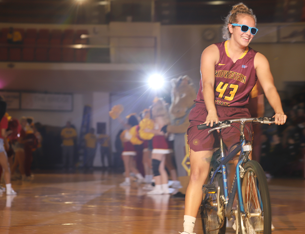 Marketing junior Liz Cathcart makes her debut on the court in style during Mustang Madness Oct. 25.