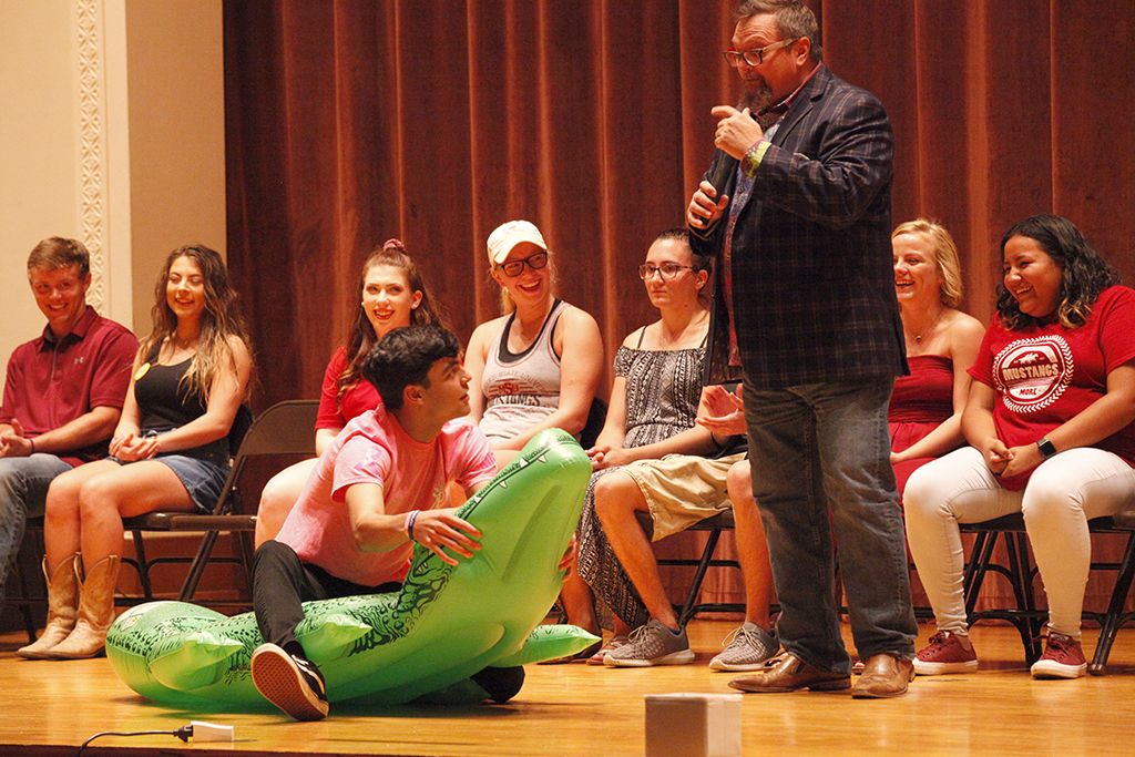 Comedy Hypnotist C.J. Johnson has Ryan Acosta, radiology sophomore, believe he is Steve Erwin trying to catch a crocodile.