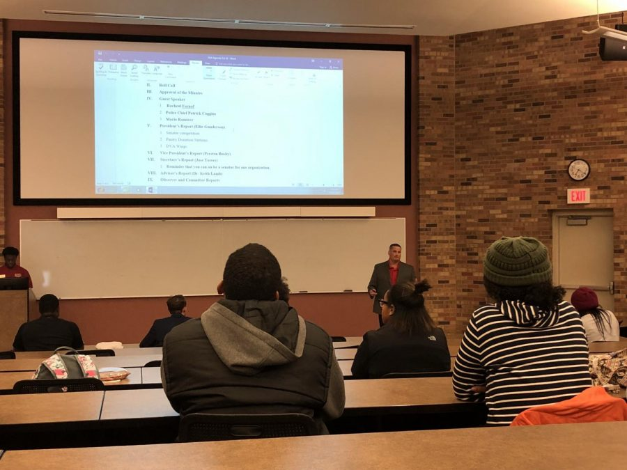 Students listen to Patrick Coggins, chief of police, discuss the campus safety app at the student government association meeting on Oct. 16. Photo by Chloe Phillips