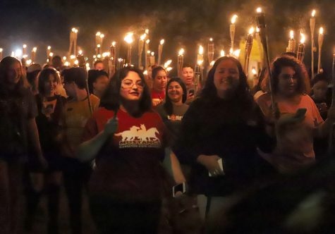 Students march in the Torchlight parade.