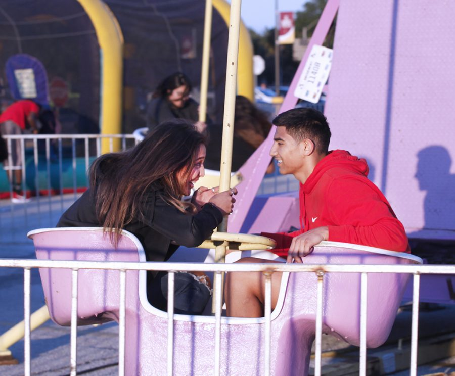 Ariana Alonso, criminal justice sophomore, and Demian Ponce, mass communication sophomore, catch their breath after spinning on the ride at MSU Texas Fair at Nocona Trail Oct.25.