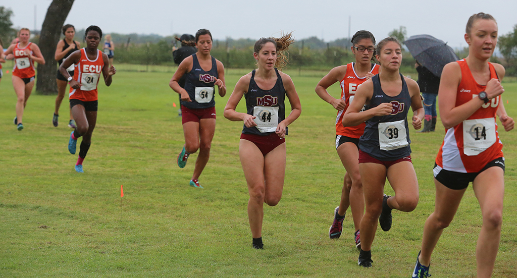 Exercise physiology junior Mercy Yermo and nursing sophomore Delaney Locke trail behind criminal justice sophomore Michelle Estrada at the MSU Texas Invitational (5K) held at the River Creek Golf Course, Oct. 19, 2018.