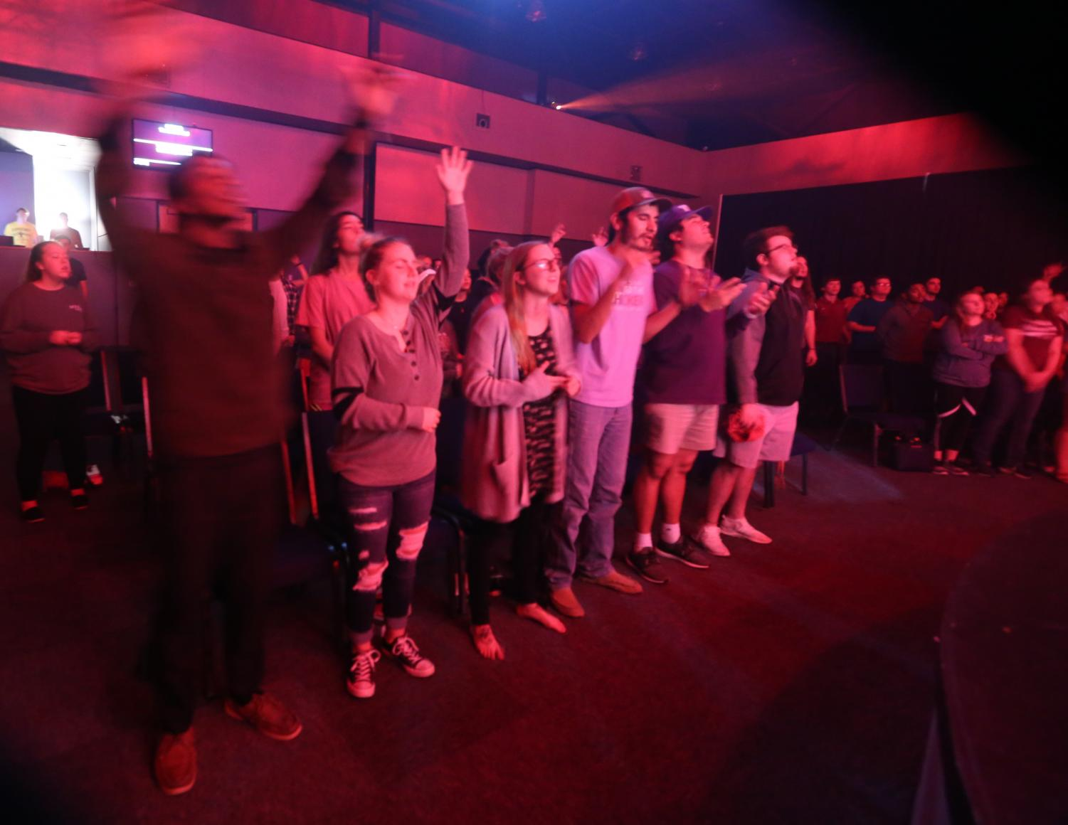 Students worship at The Bridge, a college worship service affiliated with First Baptist Church, Oct. 23, 2018.