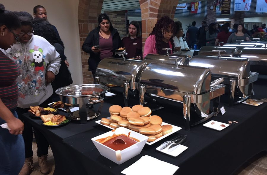 Students stand in line and get food at Mavericks 12th birthday party in CSC Comache Suites and Atrium Oct. 24.