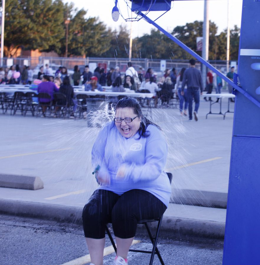 Kerry Gage, education sophmore, gets soaked after friends hit the target on the pitch burst at the MSU Texas Fair at Nocona Trail Oct.25.