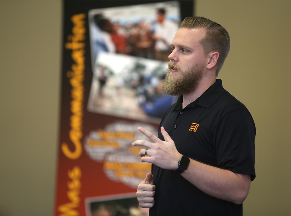 Logan Draper, digital marketing director at DesignWorks Group in Wichita Falls, discusses using Instagram at the third MSU Texas Social Media Day, Oct. 1, 2018.
