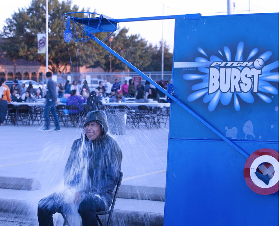 Jose Rameriez gets drenched by the balloon at the pitch burst at the MSU Texas Fair at Nocona Trail Oct.25.