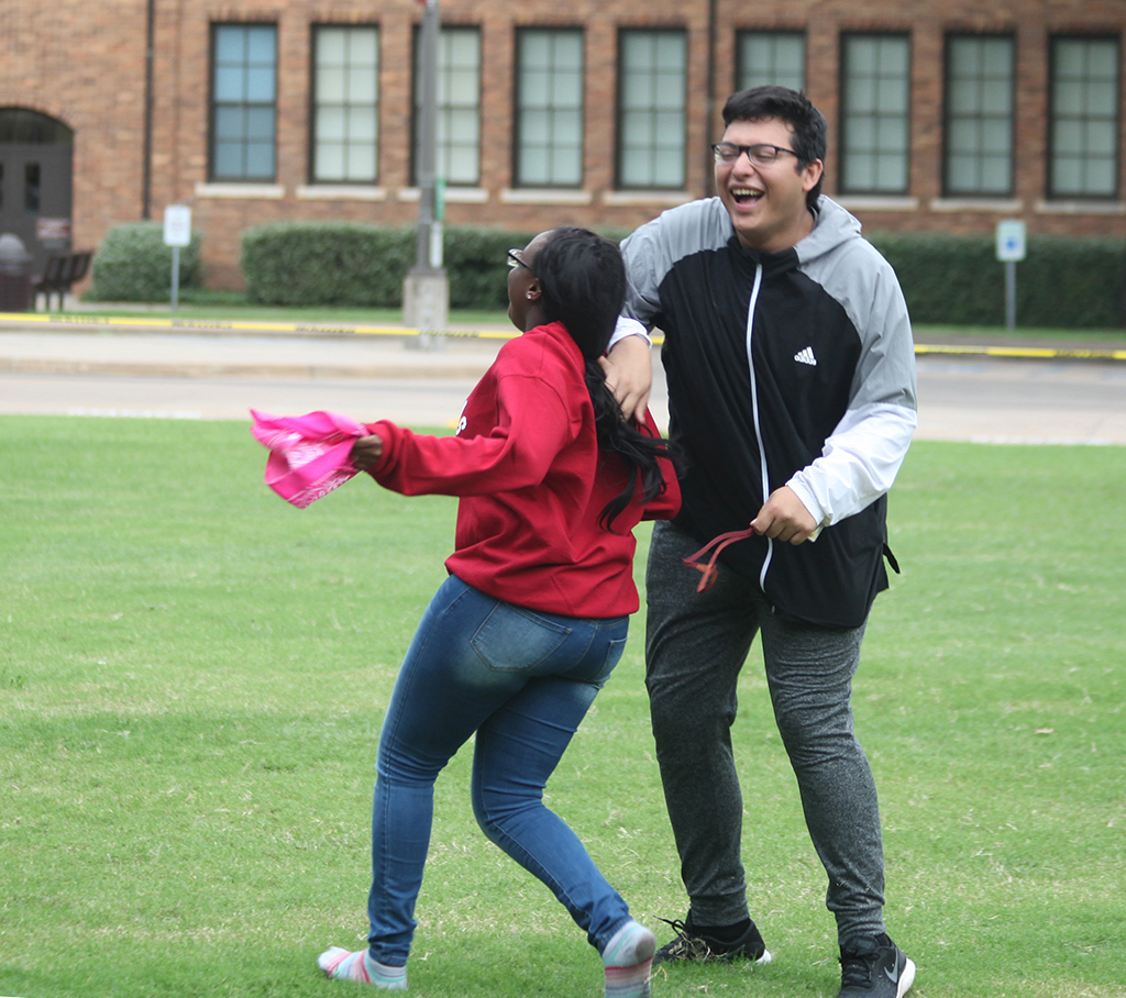 Brooke Scott, nursing freshman, and Lorenzo Paredes, biology freshman, play tag on the Quad Oct. 8, 2018. Photo by Nathan Martinez