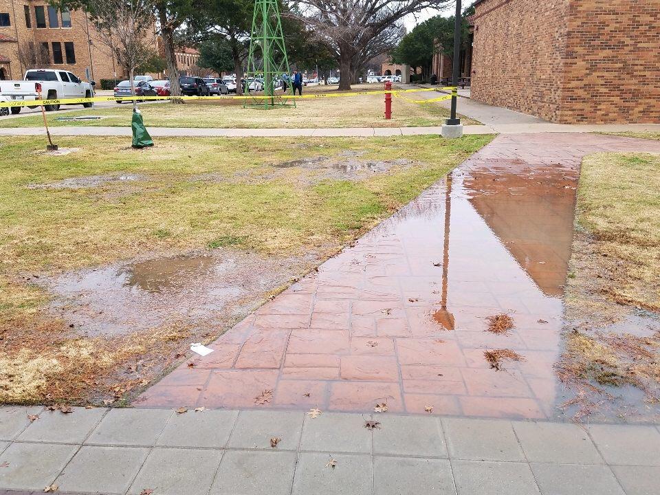 Water+from+broken+pipe+covering+sidewalk+outside+Clark+Student+Center