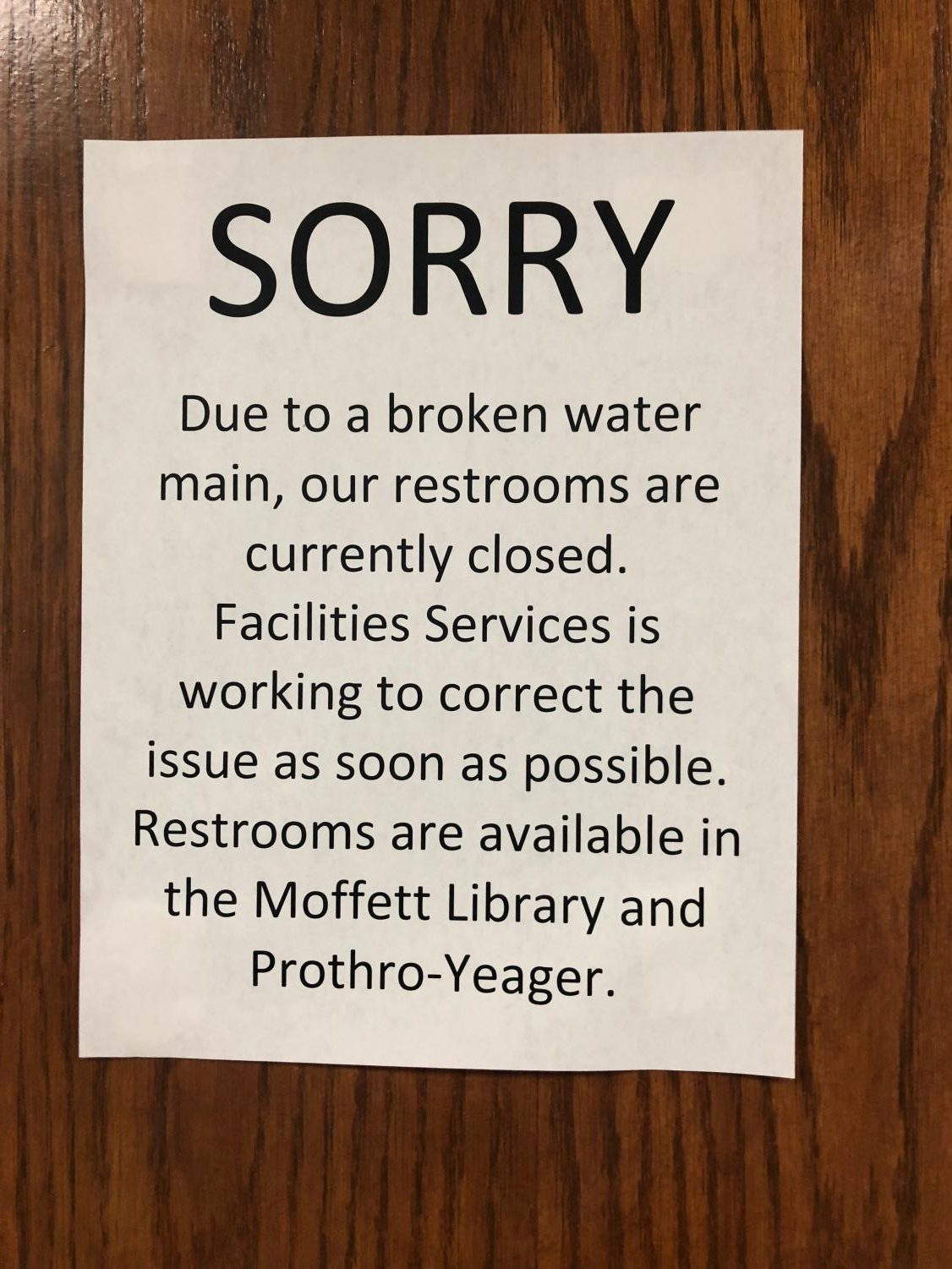 close up of sign posted on restroom door in Clark Student Center