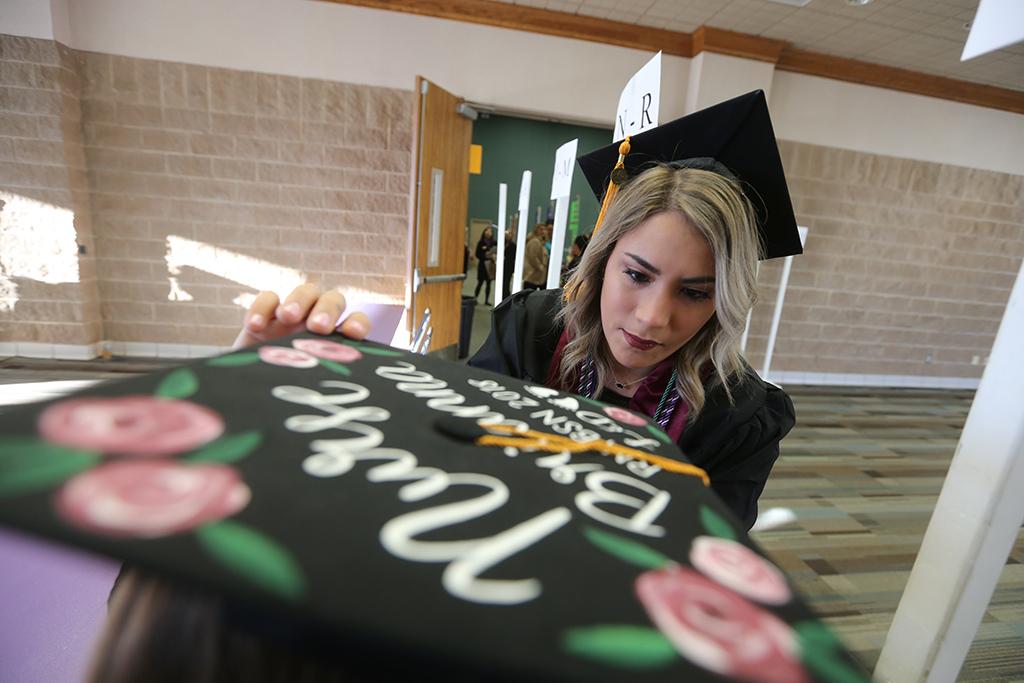 Flora+Huizar+helps+Brianna+Davis+at+Midwestern+State+University+graduation+Dec.+15%2C+2018.+%22I+was+proud+of+my+job+and+nursing+isn%27t+easy%2C%22+Dans+said.+Photo+by+Bradley+Wilson