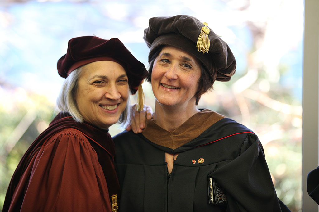 Professor+of+Art+Catherine+Prose+and+Associate+Professor+Dr.+Ann+Marie+Leimer+pose+for+the+camera+before+the+Fall+2018+Graduation+ceremony+on+Dec.+15+in+the+MPEC