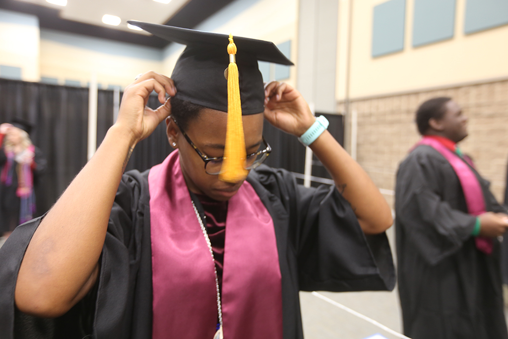 Brandi+Hobson+who+completed+her+bachelor+of+science+degree+works+on+her+mortar+board+before+graduation.+Hobson+said+she+wanted+to+be+a+coach+and+PE+teacher.+Her+hat+sported+%22many+tears+later%22+from+Sponge+Bob+Square+Pants.+%22It%27s+a+great+show%2C%22+she+said.+%22He+makes+me+laugh+and+relieve+stress.%22+Photo+by+Bradley+Wilson