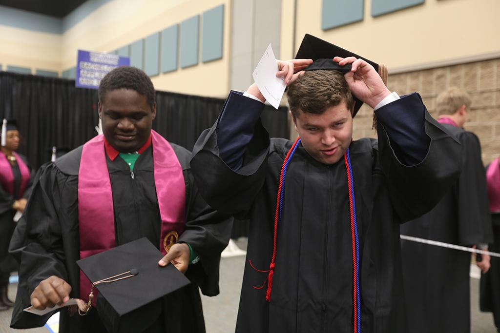 Jacob+Warren+adjusts+his+hat+before+grdaution+at+Midwestern+State+University+graduation+Dec.+15%2C+2018.+Photo+by+Bradley+Wilson