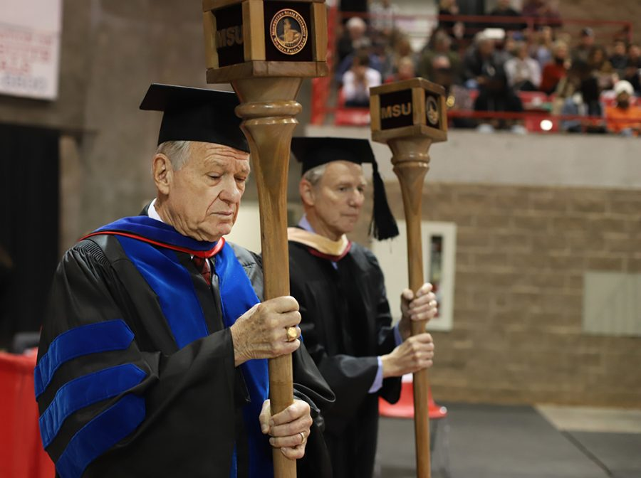 Harry Hewitt, professor of history, and Don Maxwell, professor of music lead the faculty into the coliseum to begin the graduation ceremony on Dec. 15.