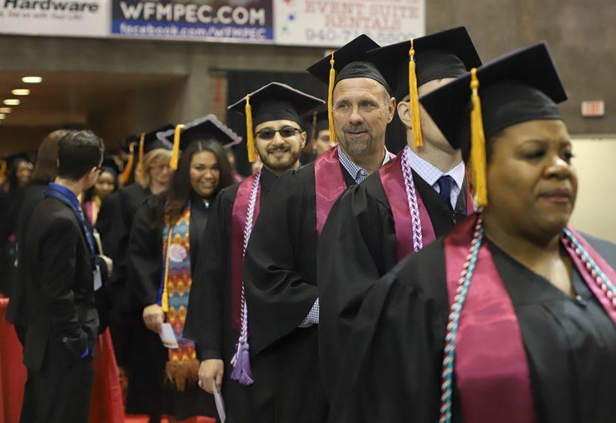 Martin Majewski, nursing, stands along side fellow graduates as they enter the coliseum for the graduation ceremony on Dec. 15.