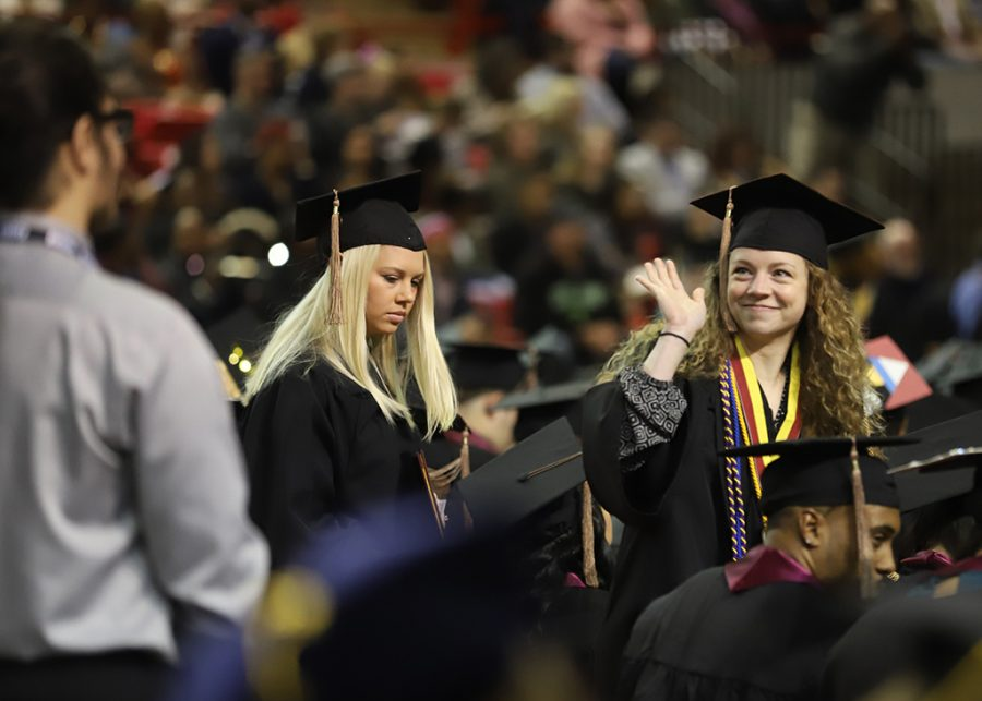 Catherine Ryan, general business, waves to her family after recieving her diploma at the graduation ceremony on Dec. 15.