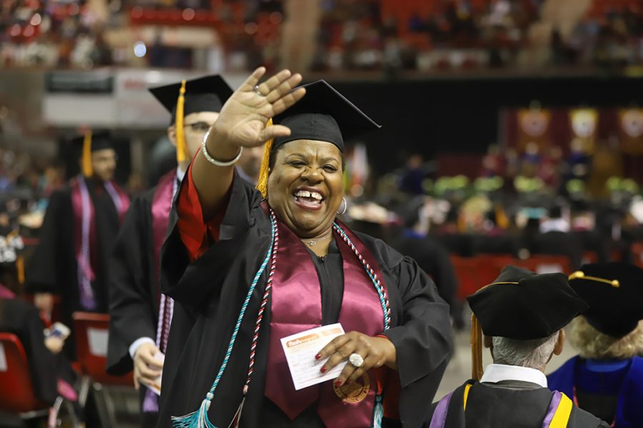 Nolita Isbelle, nursing, waves to friends and family before walking the stage at the graduation cermony on Dec. 15.