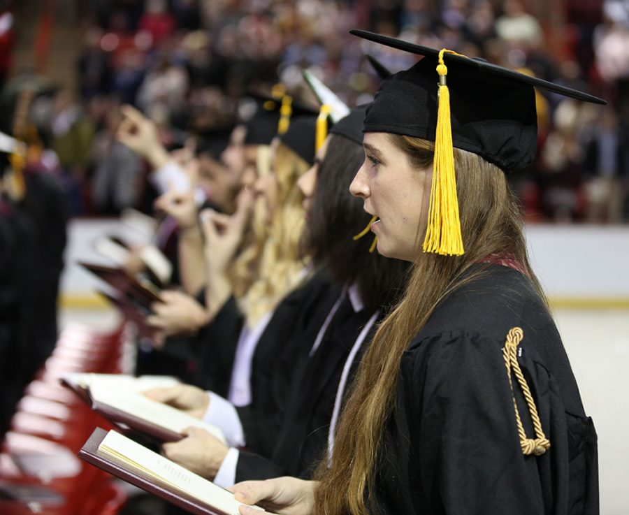 Jackie Zeizinger sings the Alma Mater with her fellow graduates during the Fall 2018 Graduation ceremony on Dec. 15 at the MPEC. Photo by Jared Bruner