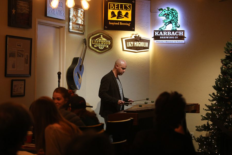 Mike Brenmark, music education senior, plays the marimba at Frank And Joes Coffee House. Photo by Nathan Martinez