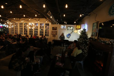 Micayla Kelsey, music freahman, performs at Frank And Joe's Coffee House before finals. Photo by Nathan Martinez