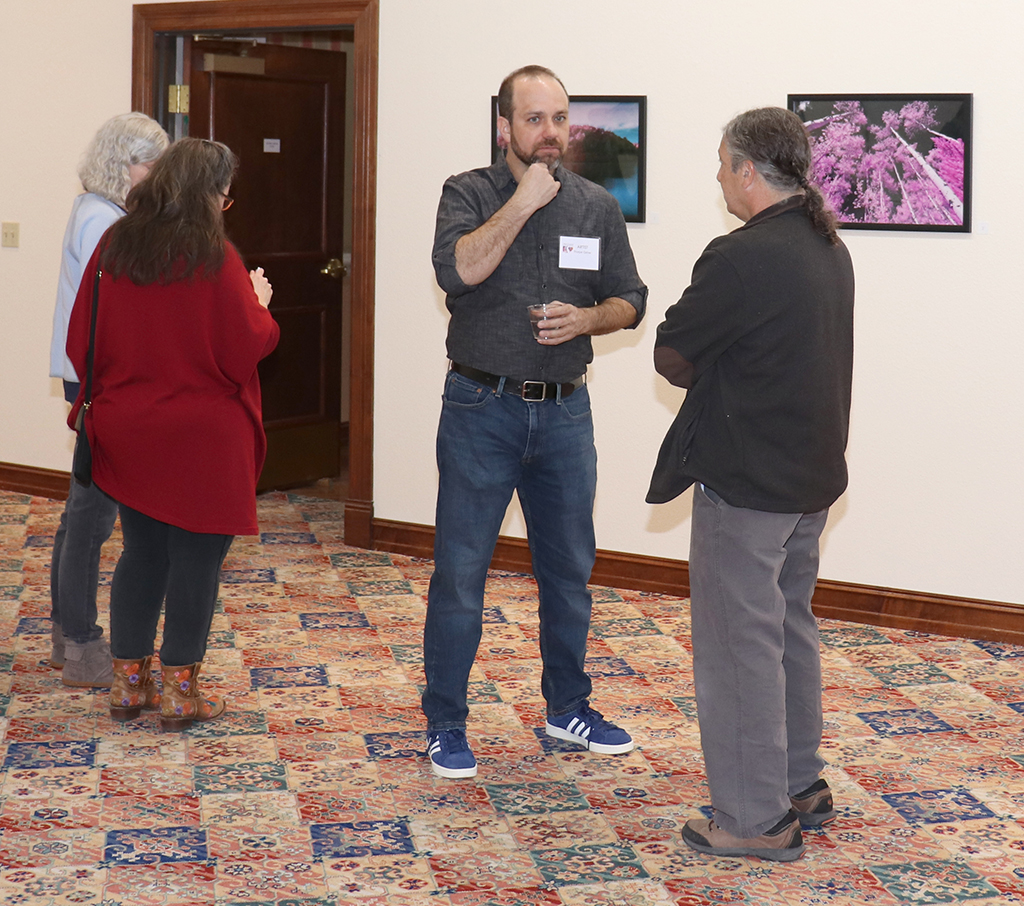 Thorpe Griner speakers to professor and Juanita Harvey Art Gallery Director Gary Goldberg at the arts council Jan. 17.